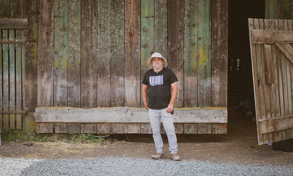 CannaCraft Co-founder Dennis Hunter in front of barn